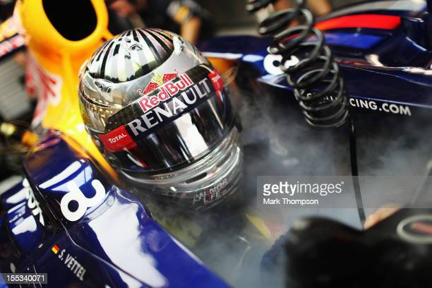 Sebastian Vettel of Germany and Red Bull Racing keeps cool as he prepares to drive during the final practice session prior to qualifying for the Abu...