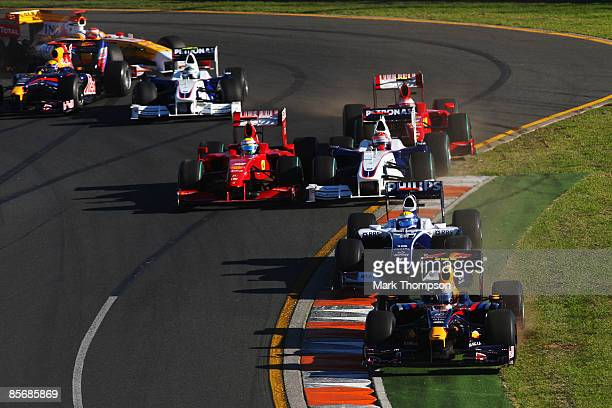 Sebastian Vettel of Germany and Red Bull Racing leads a pack of cars during the Australian Formula One Grand Prix at the Albert Park Circuit on March...