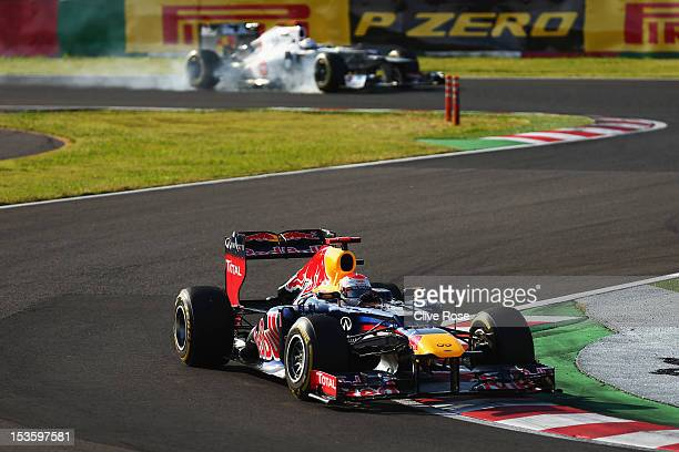 Sebastian Vettel of Germany and Red Bull Racing leads from Kamui Kobayashi of Japan and Sauber F1 during the Japanese Formula One Grand Prix at the...