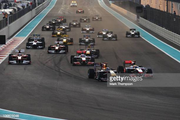 Sebastian Vettel of Germany and Red Bull Racing leads from Lewis Hamilton of Great Britain and McLaren Mercedes into the first corner at the start of...