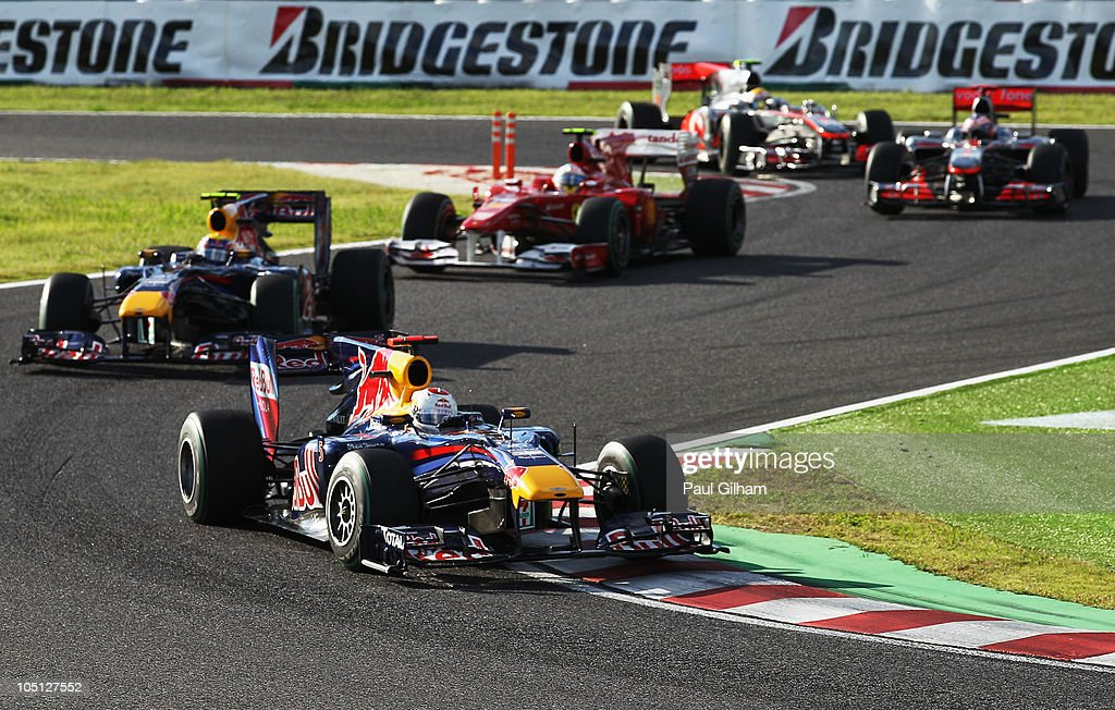 Sebastian Vettel of Germany and Red Bull Racing leads from Mark Webber of Australia and Red Bull Racing, Fernando Alonso of Spain and Ferrari, Jenson Button of Great Britain and McLaren Mercedes and Lewis Hamilton of Great Britain and McLaren Mercedes during the Japanese Formula One Grand Prix at Suzuka Circuit on October 10, 2010 in Suzuka, Japan.