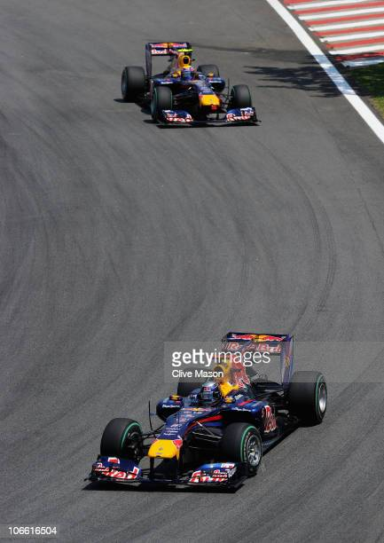 Sebastian Vettel of Germany and Red Bull Racing leads from Mark Webber of Australia and Red Bull Racing during the Brazilian Formula One Grand Prix...