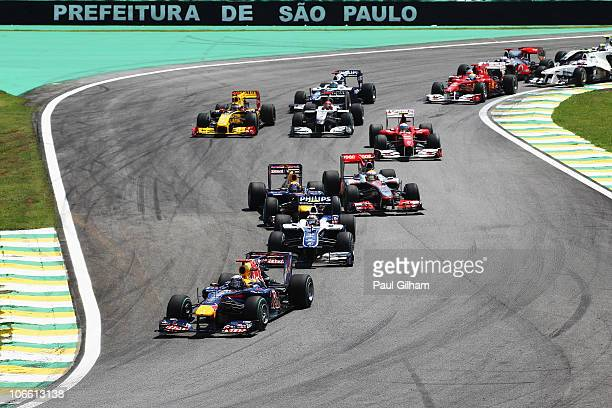 Sebastian Vettel of Germany and Red Bull Racing leads the field at the start of the Brazilian Formula One Grand Prix at the Interlagos Circuit on...