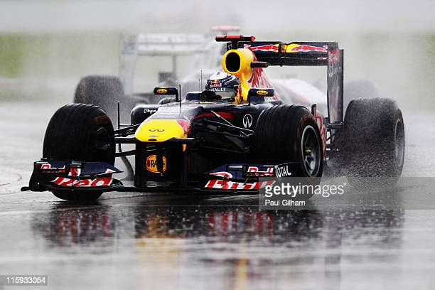 Sebastian Vettel of Germany and Red Bull Racing leads the field in the early stages of the Canadian Formula One Grand Prix at the Circuit Gilles...