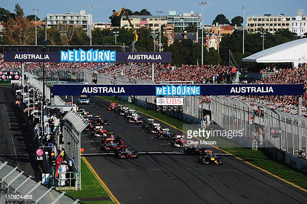 Sebastian Vettel of Germany and Red Bull Racing leads the field during the start of the Australian Formula One Grand Prix at the Albert Park Circuit...