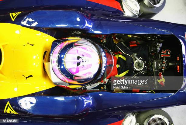 Sebastian Vettel of Germany and Red Bull Racing looks on from his cockpit during Formula One winter testing at the Ricardo Tormo circuit on February...