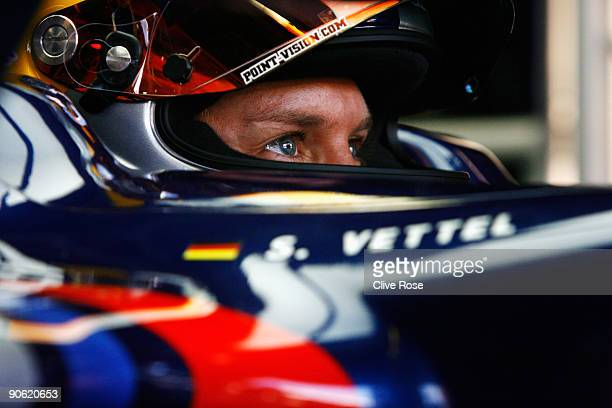 Sebastian Vettel of Germany and Red Bull Racing prepares in his team garage during the final practice session prior to qualifying for the Italian...