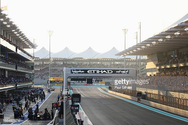 Sebastian Vettel of Germany and Red Bull Racing prepares to start the race from the pitlane before the Abu Dhabi Formula One Grand Prix at the Yas...