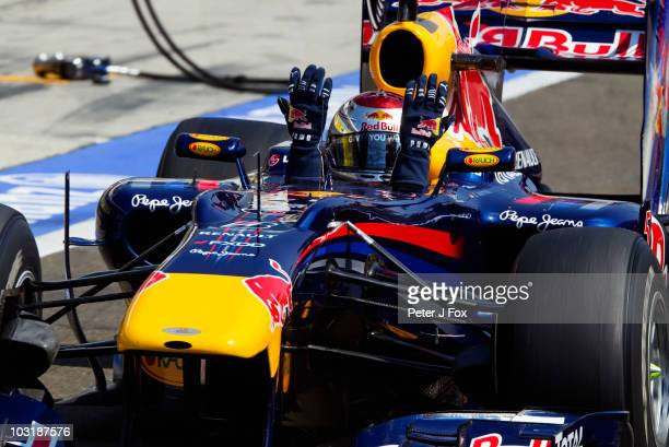 Sebastian Vettel of Germany and Red Bull Racing reacts to his penalty drive thru as he goes down the pitlane during the Hungarian Formula One Grand...
