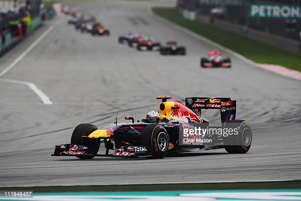Sebastian Vettel of Germany and Red Bull Racing takes a big early lead at the start of the Malaysian Formula One Grand Prix at the Sepang Circuit on...