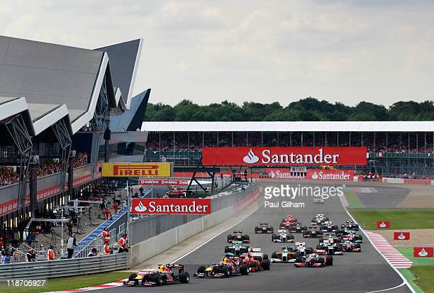 Sebastian Vettel of Germany and Red Bull Racing takes the lead at the start of the the British Formula One Grand Prix at the Silverstone Circuit on...