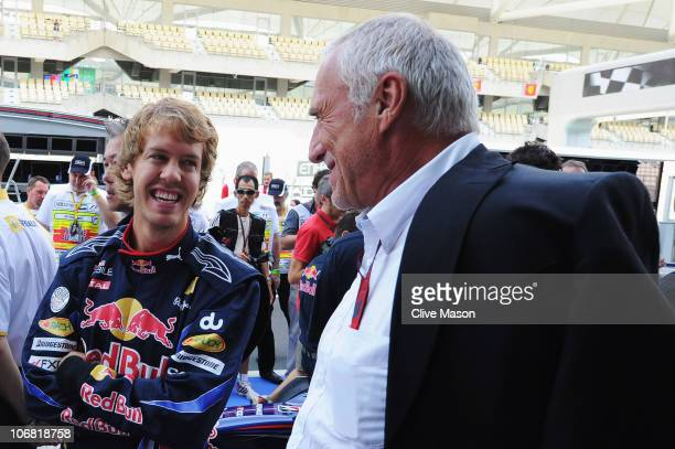 Sebastian Vettel of Germany and Red Bull Racing talks with Red Bull Racing team owner Dietrich Mateschitz before the Abu Dhabi Formula One Grand Prix...