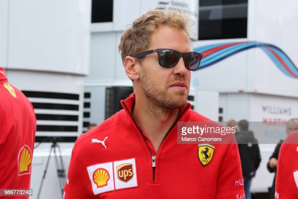 Sebastian Vettel of Germany and Scuderia Ferrari in the paddock during previews ahead of the Formula One Grand Prix of Austria
