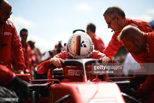 Sebastian Vettel of Germany and Scuderia Ferrari prepares on the grid before the start of the Formula 1 Grand Prix of Italy at Autodromo di Monza on...