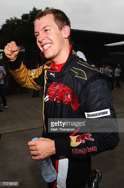 Sebastian Vettel of Germany and Scuderia Toro Rosso celebrates after finishing fourth in the Chinese Formula One Grand Prix at the Shanghai...