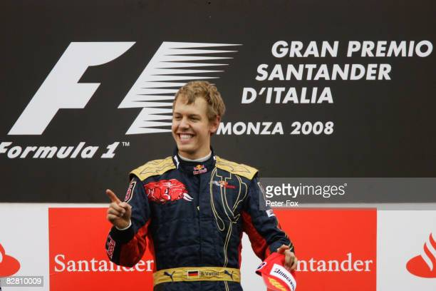 Sebastian Vettel of Germany and Scuderia Toro Rosso celebrates on the podium after winning the Italian Formula One Grand Prix at the Autodromo...