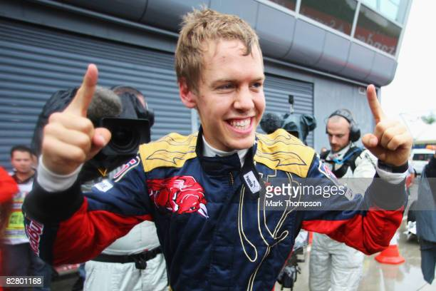Sebastian Vettel of Germany and Scuderia Toro Rosso celebrates taking pole position after qualifying first for the Italian Formula One Grand Prix at...