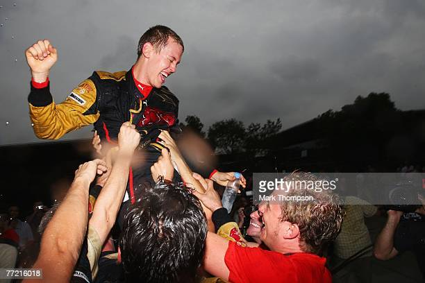 Sebastian Vettel of Germany and Scuderia Toro Rosso celebrates with team mates after finishing fourth in the Chinese Formula One Grand Prix at the...