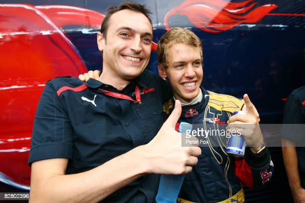 Sebastian Vettel of Germany and Scuderia Toro Rosso celebrates with team mates after taking pole position for the Italian Formula One Grand Prix at...