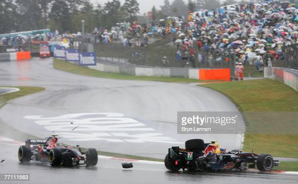 Sebastian Vettel of Germany and Scuderia Toro Rosso collides with Mark Webber of Australia and Red Bull Racing during the Japanese Formula One Grand...