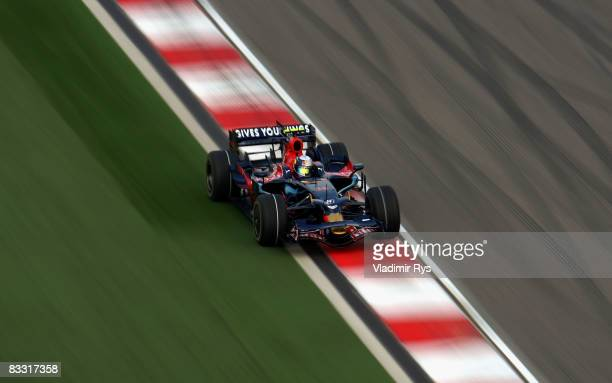 Sebastian Vettel of Germany and Scuderia Toro Rosso drives during practice for the Chinese Formula One Grand Prix at the Shanghai International...