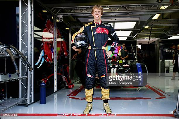 Sebastian Vettel of Germany and Scuderia Toro Rosso in the pits during the Hungarian Formula One Grand Prix Practice at the Hungaroring on August 3...