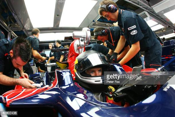 Sebastian Vettel of Germany and Scuderia Toro Rosso sits in his car before driving to pole position in qualifying for the Italian Formula One Grand...