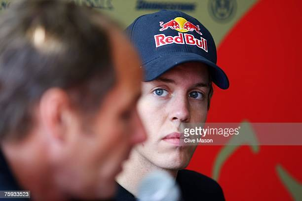 Sebastian Vettel of Germany and Scuderia Toro Rosso sits in the paddock with Gerhard Berger during the Hungarian Formula One Grand Prix Previews at...