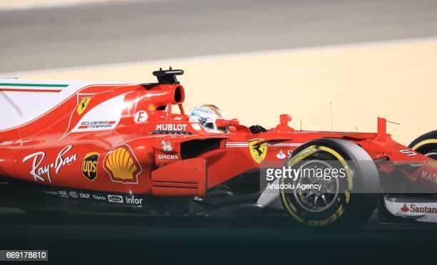 Sebastian Vettel of Germany drives the Ferrari on track during the Bahrain Formula One Grand Prix a threeway battle at Bahrain International Circuit...