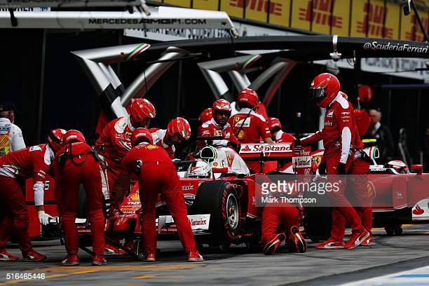 Sebastian Vettel of Germany drives the Scuderia Ferrari SF16H Ferrari 059/5 turbo in the Pitlane during qualifying for the Australian Formula One...