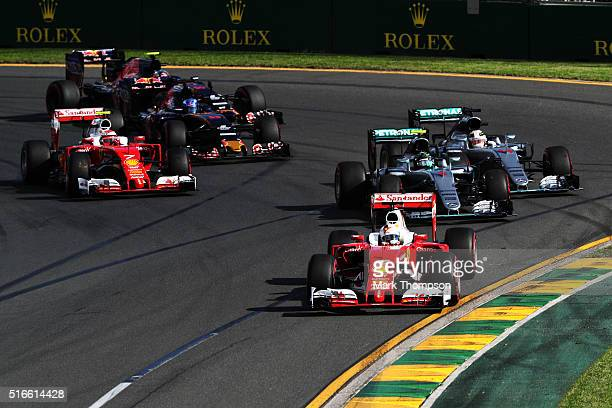 Sebastian Vettel of Germany drives the Scuderia Ferrari SF16H Ferrari 059/5 turbo leads the field at the start during the Australian Formula One...
