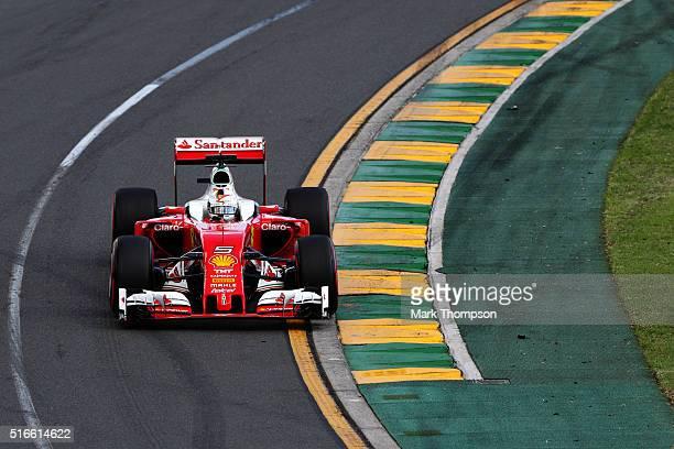 Sebastian Vettel of Germany drives the Scuderia Ferrari SF16H Ferrari 059/5 turbo during the Australian Formula One Grand Prix at Albert Park on...