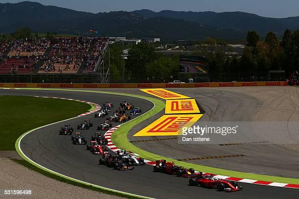 Sebastian Vettel of Germany drives the Scuderia Ferrari SF16H Ferrari 059/5 turbo ahead of Max Verstappen of Netherlands and Red Bull Racing and...