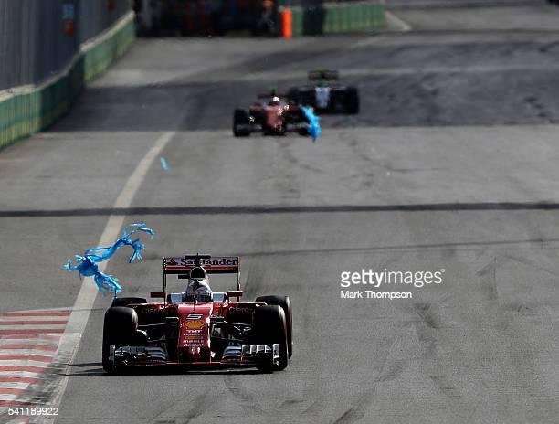 Sebastian Vettel of Germany driving the Scuderia Ferrari SF16-H Ferrari 059/5 turbo comes into contact with some plastic on track during the European...