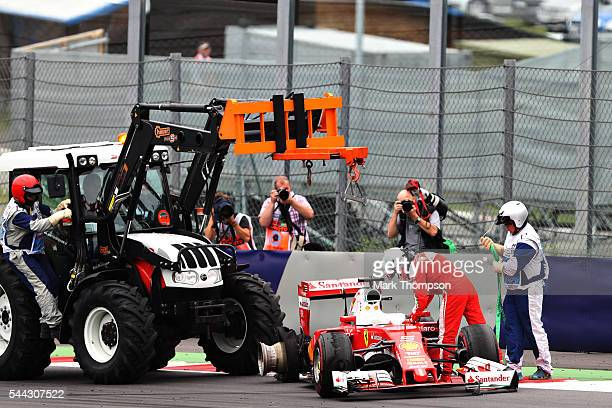 Sebastian Vettel of Germany driving the Scuderia Ferrari SF16H Ferrari 059/5 turbo is removed from the track after crashing during the Formula One...
