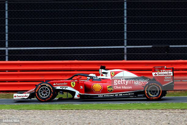 Sebastian Vettel of Germany driving the Scuderia Ferrari SF16H Ferrari 059/5 turbo on track with the halo fitted during practice for the Formula One...
