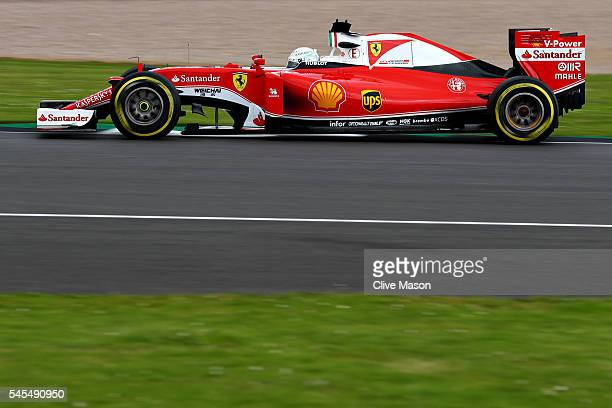 Sebastian Vettel of Germany driving the Scuderia Ferrari SF16H Ferrari 059/5 turbo on track during practice for the Formula One Grand Prix of Great...
