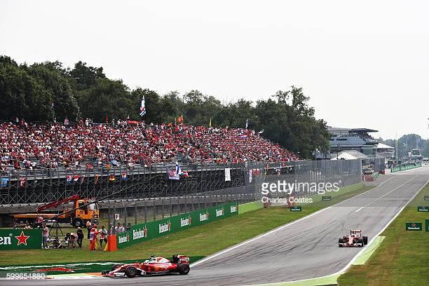 Sebastian Vettel of Germany driving the Scuderia Ferrari SF16H Ferrari 059/5 turbo leads Kimi Raikkonen of Finland driving the Scuderia Ferrari SF16H...