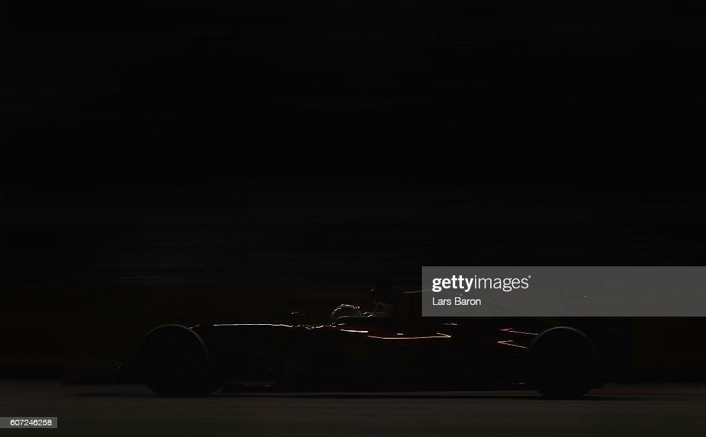Sebastian Vettel of Germany driving the (5) Scuderia Ferrari SF16-H Ferrari 059/5 turbo (Shell GP) on track during qualifying for the Formula One Grand Prix of Singapore at Marina Bay Street Circuit on September 17, 2016 in Singapore.