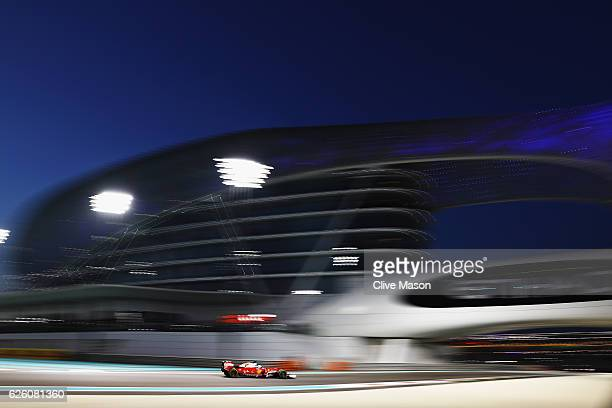 Sebastian Vettel of Germany driving the Scuderia Ferrari SF16-H Ferrari 059/5 turbo on track during the Abu Dhabi Formula One Grand Prix at Yas...