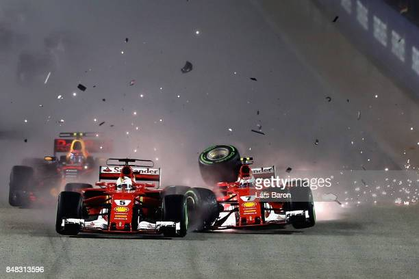 Sebastian Vettel of Germany driving the Scuderia Ferrari SF70H and Kimi Raikkonen of Finland driving the Scuderia Ferrari SF70H collide at the start...