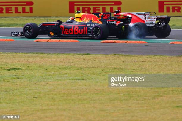 Sebastian Vettel of Germany driving the Scuderia Ferrari SF70H and Max Verstappen of Netherlands and Red Bull Racing collide at the start during the...