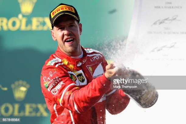 Sebastian Vettel of Germany driving the Scuderia Ferrari SF70H celebrates his win on the podium during the Australian Formula One Grand Prix at...