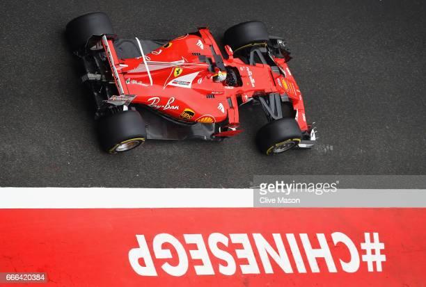 Sebastian Vettel of Germany driving the Scuderia Ferrari SF70H in the Pitlane during the Formula One Grand Prix of China at Shanghai International...
