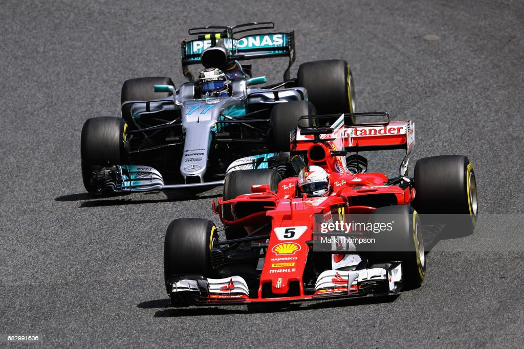 Sebastian Vettel of Germany driving the (5) Scuderia Ferrari SF70H leads Valtteri Bottas driving the (77) Mercedes AMG Petronas F1 Team Mercedes F1 WO8 on track during the Spanish Formula One Grand Prix at Circuit de Catalunya on May 14, 2017 in Montmelo, Spain.