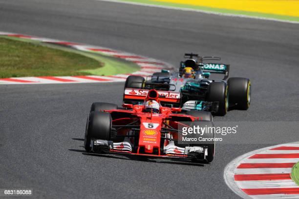 DE CATALUNYA MONTEMELò BARCELONA SPAIN Sebastian Vettel of Germany driving the Scuderia Ferrari SF70H leads Lewis Hamilton of Great Britain driving...