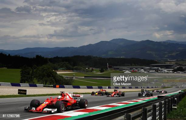 Sebastian Vettel of Germany driving the Scuderia Ferrari SF70H leads a group of cars during the Formula One Grand Prix of Austria at Red Bull Ring on...