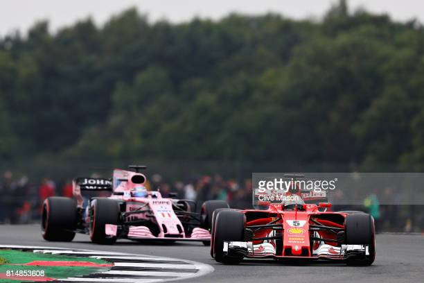 Sebastian Vettel of Germany driving the Scuderia Ferrari SF70H leads Sergio Perez of Mexico driving the Sahara Force India F1 Team VJM10 on track...