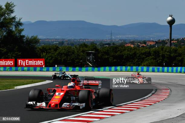 Sebastian Vettel of Germany driving the Scuderia Ferrari SF70H leads the race during the Formula One Grand Prix of Hungary at Hungaroring on July 30...