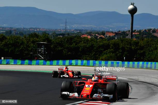Sebastian Vettel of Germany driving the Scuderia Ferrari SF70H leads Kimi Raikkonen of Finland driving the Scuderia Ferrari SF70H on track during the...
